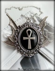 Gothic bat wing ankh necklace.  TheCryptOfCuriosities on Etsy