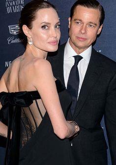 Angelina Jolie Cuddles Up to Brad Pitt in Satin Bow Pumps at the WSJ Magazine 2015 Innovator Awards