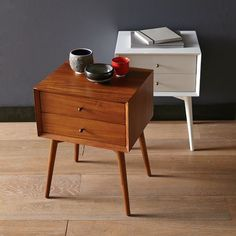 "Mid Century nightstand Past perfect. Equipped with two roomy drawers, the Mid-Century Nightstand borrows its slim legs, angled face and understated retro details from iconic '50s and '60s furniture silhouettes. • Solid wood legs and frame. • Engineered wood body. • 18""w x 15""d x 24""h. • Beveled front edges. • Drawers on metal glides; antique bronze knobs. • Minimal assembly. • Wipe clean. • Imported."