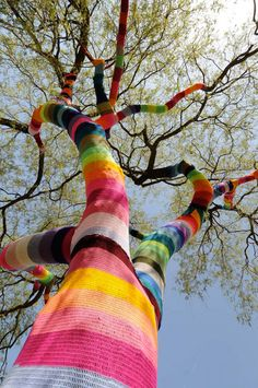 knitted tree rainbow magic art.  i would climb that for SURE.  and have a hot firefighter rescue me.  MeeOw!