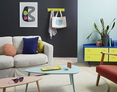 The typical kiwi bach was the inspiration for this room, using a mix of colours from soft sea blue to bright primary colours like yellow and cobalt blue to repr. Living Room Paint, Living Room Colors, Living Room Grey, Living Room Decor, Colours That Go With Grey, Office Wall Colors, Half Painted Walls, Retro Sideboard, Painted Coffee Tables
