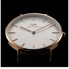 Daniel Wellington watch Brand new Inspired Daniel Wellington watch . Unisex for man and girls . 40 mm diameter , water resistant . Gold face and black strap .Please no Trades , dont lowball me . I have a perfect rating , trusted seller and fast shipper . Very beautiful and for a great price :D happy customers happy seller Daniel Wellington Accessories Watches