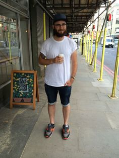 Mens Fashion on Commercial Street, London E1. Ray-Ban Clubmaster sunglasses, Acne jeans (cut-up), Supreme tee, Norse Projects Cap, Nike 90 black infrared reverse Trainers, (Watches & Fashion | WTCH)
