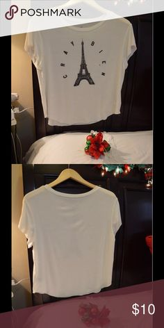 Soft and sexy t shirt Eiffel Tower white Brand new ! Never worn item . The material is truly soft which is why I bought it to begin with but it never fit me right so it's just been hanging in my closet ever since I bought it. It's brand new but it doesn't have the tags on :/ it has the sticker though! Which is why I listed it as new with tags American Eagle Outfitters Tops Tees - Short Sleeve