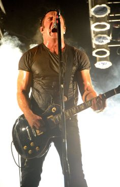 Trent Reznor.  I am baffled that so many people on Pinterest think this is Dave Matthews.