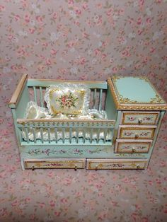 Aida Pravia - hand painted crib with built in dresser