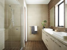 Floor to ceiling wood-look tiles and neutral tones create a nature-inspired bathroom retreat with Linen countertops by Boutique Homes. Dream Bathrooms, Beautiful Bathrooms, Wood Look Tile, Boutique Homes, Wood Ceilings, House Numbers, Living Room Furniture, Countertops, New Homes