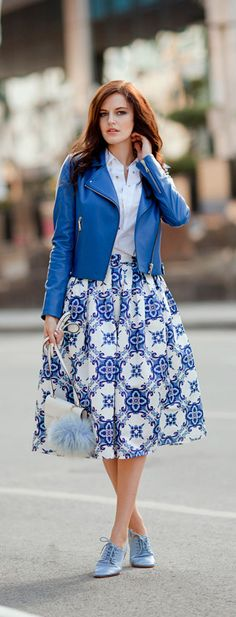 Our Blue Kaleidoscopic Pleated midi skirt is the perfect visual you need to take your wardrobe to another level! Step out in a pair of  top and classy heels to complete your look!   tiebow-tie