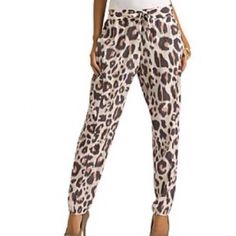 Kardashian Kollection Pink Leopard Pants  A casual, classy and comfort fit. Never been worn. Kardashian Kollection- women's drawstring pant- leopard print-32063. Elasticized drawstring waist. Side seem pockets. Relaxed fit. Tapered leg. Woven construction. Fabric 100% polyester. Care machine wash. Kardashian Kollection Pants