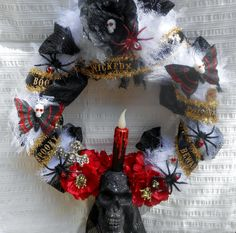 This 12 x 12 wreath has a black, glittery scull with a candle that lights up. No need to plug it in, theres a switch on the bottom of the skull