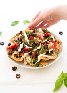 A fun twist on the original. These Italian Nachos are loaded with a homemade Parmesan cheese sauce, spicy Italian sausage and roasted bell peppers.