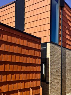 Terracotta tiles and recycled brick were used for the facade. Recycled Brick, Architectural Materials, Tower House, Victorian Cottage, Building A New Home, Architect Design, Concrete Floors, Building Materials, Terracotta