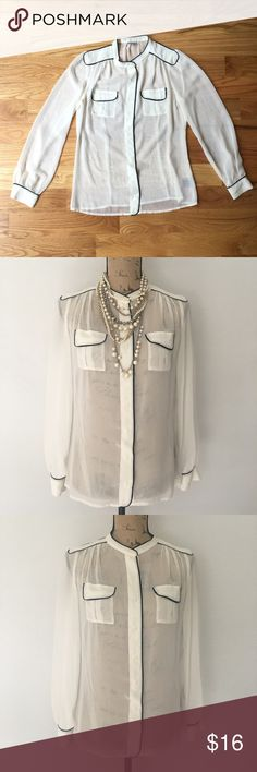 """Sheer cream and black lined seed blouse About: • brand: Worthington • size: small • cream in color with black lined trim • button and pleating embellishments  • great with skinnies or tucked into a pencil skirt  • necklace not included   Measurements: • bust: 38"""" • length: 25.25""""  #worthington #blouse #small #sizesmall #sizes #cream #black #blacktrim #blacklining #buttons #pleating #sheer #seethrough #office #dressy #collared #collar #blouse #interview Worthington Tops Blouses"""