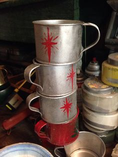 Tin cups my Uncle Keith used with his logging crews. Repurposed into Christmas tree ornaments.