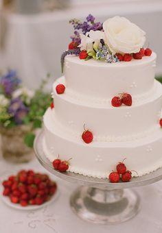 A three-tier, strawberry and vanilla wedding cake | Brides.com