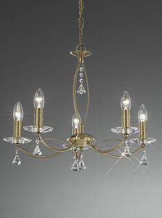 FL2228/5 Monaco 5 light pendant or flush bronze and crystal glass. Bronze fitting with crystal glass sconces and drops. Supplied with chain suspension which is easily converted to a flush fitting suitable for lower ceilings. 5 x 60w E14 Candle Lamps not included Height- 97cm Minimum Height- 46cm Diameter- 58cm BRAND: Franklite REFERENCE- FL2228/5 AVAILABILITY: 3-4 Working Days