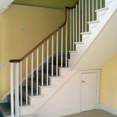 Cut string staircase with oak handrail