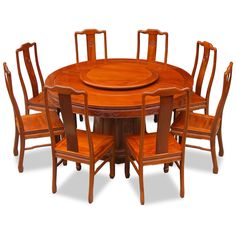Featuring exquisite Chinese key motif and longevity symbols, this Ming (1368-1644) style round dining table set is crafted from solid rosewood using traditional joinery techniques. The table comes with one removable lazy susan for your dining needs. Hand applied natural finish enhances the beauty of the rosewood grain and rounds out its quiet beauty. The set comes with eight side chairs.
