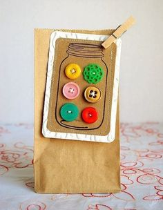 Tag: Mason jar filled with buttons-- would be a cute tag to attach to a Mason Jar gift. (ie the apron stuffed in a Mason Jar with recipe)