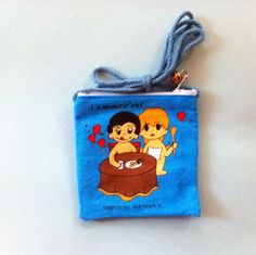 A personal favorite from my Etsy shop https://www.etsy.com/listing/264658117/love-is-fabric-pouch-blue-string-coin