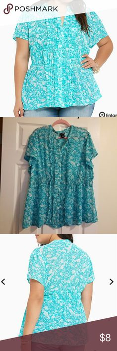 Torrid plus size Rose Print Chiffon Smocked blouse A rose print for a rose, you deserve it! This turquoise chiffon flutter sleeved style has a ruffed button front and a fit-and-flare smocked waist. It's a silhouette you'll love that'll have you feeling as pretty as a rose. Torrid size 3 torrid Tops Blouses