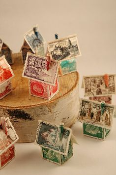 Hey-Sign Stamp Tischläufer 11 rot Hey SignHey SignHey-Sign Stamp Tischläufer 11 rot Hey SignHey SignLittle tiny houses that would be great for a winter village decorationThese little houses made from stamps would be Recycled Crafts, Diy Crafts, Foam Crafts, Art Postal, Postage Stamp Art, Glitter Houses, Paper Houses, Art Houses, House Art