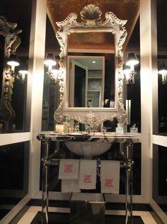 Glamorous black and white bathroom by Miles Redd