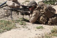 A Marine with Dog Company, 1st Battalion, 7th Marine Regiment, sets security during Operation Sangin United Horizons, May 19. Operation Sangin United Horizons was a large-scale operation, which took place May 17 through 20. Dog Company, 1st Bn., 7th Marines, was responsible for finding and destroying weapons caches, improvised explosive devices and drug producing facilities.
