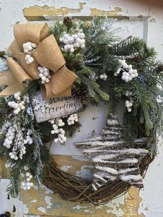 Christmas Wreath for front door, White Winter Wreath, Holiday Wreath, Christmas door decor, Christmas Star Wreath, Holiday decor  This vibrant Christmas wreath will brighten up your entryway. It is a grapevine wreath filled with quality evergreen boughs, beautiful sparkling white berries, pine cones and a lovely large burlap bow. I finished it with a beautiful grapevine star and a Seasons Greetings sign.  The finished size is 24 x 22 x 9.  Thank you for visiting my shop!  To view the rest of…