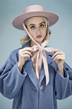 Allison Harvard is pastel perfection in our latest shoot with photographer Anna Demarco. In a wardrobe comprised of a subdued palette with blushing pinks and sweet hues, we paired a pale blue jumpsuit with our Sunset Boulevard blush felt hat and an oversized blue coat with The Heiress hat. The setting was a minimalist retro set with pale blue backdrops and vintage 1950's refrigerator, with classic armchairs and a chandelier. Stunning inside and out, Allison perfectly compliments the Bijou…