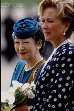 Empress Michiko of Japan is welcomed at the Brussels Airport by Queen Paola of Belgium