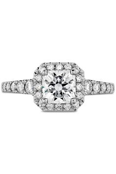 """Engagement Rings - What Your Engagement Ring Says About You -  Warm and Sweet Your ring has: A halo setting You are: A total softie, and you've got a serious romantic side. """"You love soft, ethereal, feminine things,"""" Sabatino notes. You take advantage of all nature has to offer and you probably always have a vase of fresh flowers on the cocktail table in your apartment."""