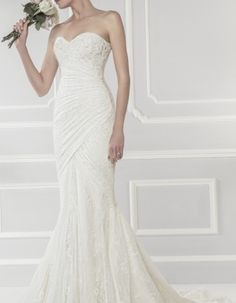 Ellis Bridal Style Exquisitely crafted in fine & corded lace, this fishtail style features a hand-embellished sweeping hem decorated with luxe sequins and hand-beaded detail. A flattering sweetheart neckline compliments the striking silhouette. Wedding Dresses Photos, Bridal Wedding Dresses, Dream Wedding Dresses, Designer Wedding Dresses, Bridal Style, Wedding Fabric, Mod Wedding, Wedding Ideas, Lace Wedding