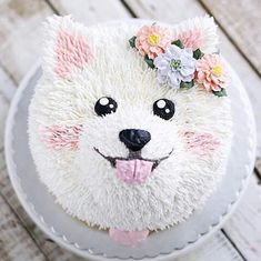 Amazing small dog cake. White and pink with flowers. It's too cute to eat ;)