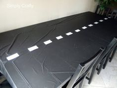 black table cloth with white duck tape