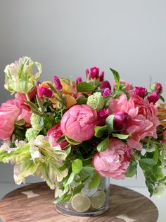 A lush flower arrangement of coral peonies, beautiful open tulips and spring greens for the flower delivery from the KD&J Botanica Studio. Peony Flower Arrangements, Beautiful Flower Arrangements, Tulips Flowers, Summer Flowers, Floral Bouquets, Silk Flowers, Beautiful Flowers, Fresh Flower Arrangement, Flower Centerpieces