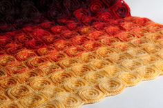 Ravelry: Fire Blanket pattern by Tanya Beliak. Now this might get me to take up crochet.