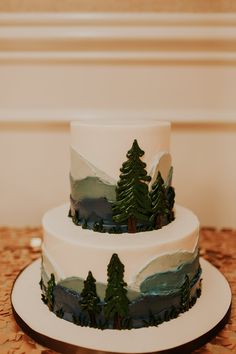 Mountaint woodland themed Groom cake for the outdoors man that likes to hike, hunt and fish placed on a sequin linen topped table at Austin Country Club with full service wedding planning by Heavenly Day Events.
