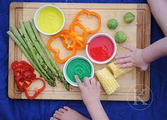 Painting with Vegetables!  Asparagus: Paint Brush!  Corn on the Cob: Paint Roller!  Peppers and Brussels Sprouts: Stamp and Smear!