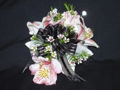 Pink and white alstroemeria and waxflower with black ribbon wrist corsage
