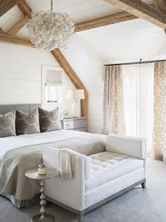 classic cottage bedroom with modern chandelier and exposed beams via coco kelley