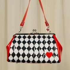 Harlequin Diamond Handbag:Feast your eyes on Hold Fast Handbags newest addition! She writes, With a retro nickel kisslock frame, this vintage-inspired handbag has a soft body with tufted vertical topstitching on the front and back sides, and a cute heart applique stitched on the lower front right corner. There is a flat rigid bottom with four domed purse feet, and the Hold... $140.00
