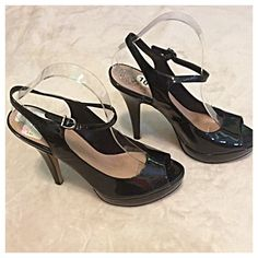 """Vince Camuto Black Patent Leather Slingback Heels Beautiful patent leather peep toe shoes with ankle straps. Heels are approximately 5"""", with a platform of about an inch in front, so they feel like 4"""" heels. 10.5"""" from heel to toe and 3"""" wide at widest point. Vince Camuto Shoes Heels"""
