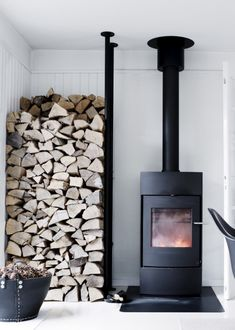 """42 Lovely Scandinavian Fireplace To Rock This Year. A stone fireplace design your pioneer ancestors would envy is the """"Multifunctional Fireplace. Scandinavian Fireplace, Scandinavian Cabin, Stone Fireplace Designs, Fireplace Ideas, Mantel Ideas, Into The Woods, Wood Burner, Wooden House, Stove Fireplace"""