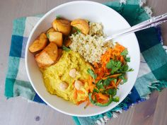 Mango curry hummus, quinoa, tangy cilantro carrot slaw: this vegan, gluten-free recipe has everything delicious in one bowl.