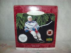 Wayne Gretzky, New York Rangers, 1st in the Hockey Greats Series Hallmark Ornament, 1997. I have this one.