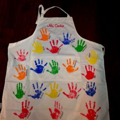 Purchase Aprons from growingcooks.com and make a Teacher Handprint Keepsake Apron! Kids hands on apron with name. Great gift & teachers love it!!