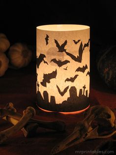 Free printable paper candle wrapper from Mr. Printables....several styles....just wrap around a glass candle holder and use tea lights  - http://www.mrprintables.com/printable-halloween-decorations-candle.html
