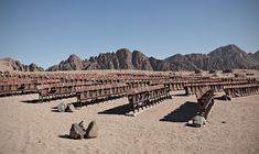 Abandoned, never-used cinema in the middle of nowhere, Sinai Desert, Egypt. The photographer is Estonian and there is a little more about this mad French project on his blog.