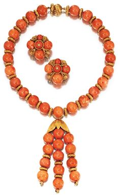 18 KARAT GOLD & CORAL TASSEL NECKLACE AND EARCLIPS, VAN CLEEF & ARPELS, NEW YORK, CIRCA 1960 $ 34,375   the necklace composed of 36 coral beads spaced by textured gold rondelles and suspending a tassel of similar design.